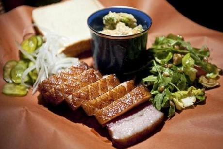 At Sweet Cheeks, barbecue is served with white bread to help sop up sauce.
